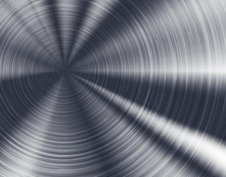 Brushed metal texture, circular metallic plate.
