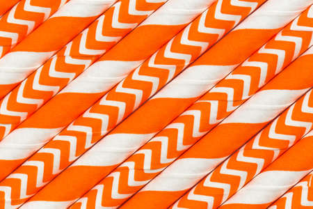 photo: Abstract background, interesting paper tubes orange pattern macro Stock Photo