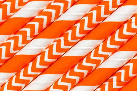 wave: Abstract background, interesting paper tubes orange pattern macro Stock Photo