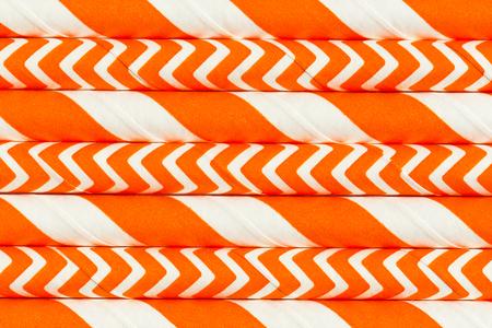 Abstract background, interesting paper tubes orange pattern macro Standard-Bild