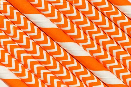 Abstract background, interesting paper tubes orange pattern macro Stock Photo