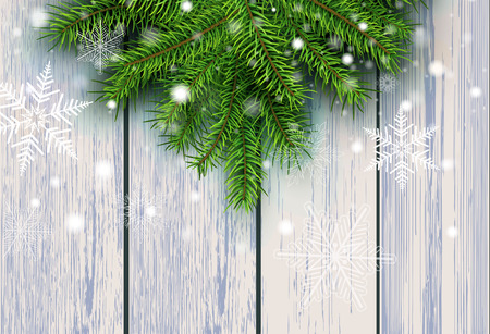 Christmas background, green fir tree decoration on old wooden board background with snowflakes