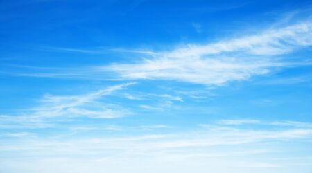 Sunny background, blue sky with white cirrus clouds