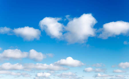 Natural summer background, blue sky with white clouds.