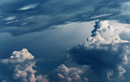 Dramatic stormy clouds as natural background, dangerous cumulonimbus clouds over dark blue sky. Stock fotó