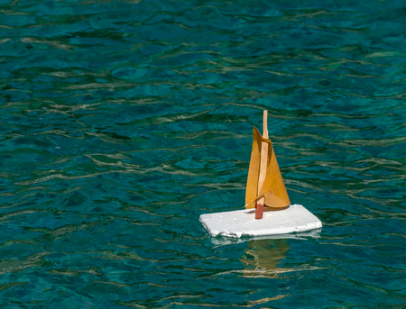 A child's boat made out of waste lying around on beaches Stock Photo - 87816785