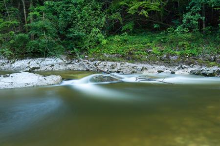Quiet river Rettenbach (Salzkammergut, Austria) in summer, long exposure Stock Photo
