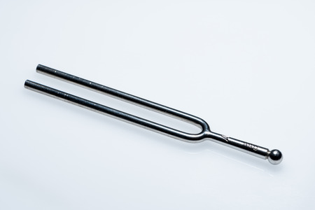 Closeup of a tuning fork 440 Hz on a white background Stock Photo