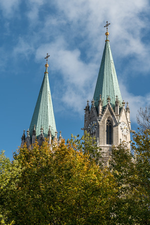 Church towers of Klosterneuburg monastery in autumn blue sky and trees (Austria)