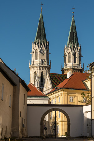 Church towers and part of abbey of Klosterneuburg monastery in autumn Stock Photo