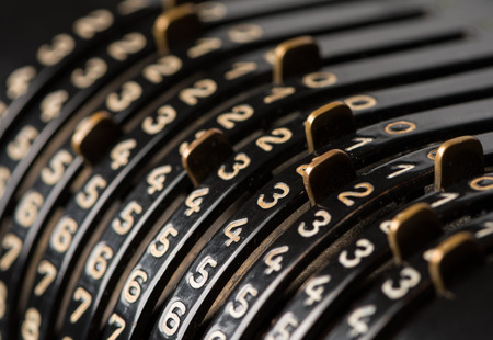 Details of a black mechanical calculator from the 19th century