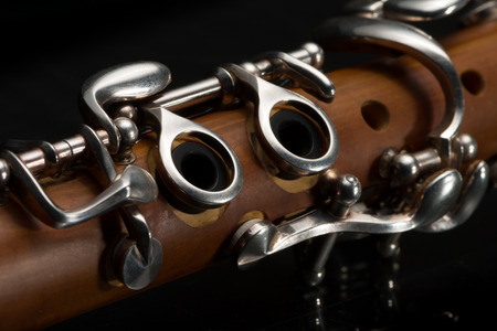 acoustics: Details of a light brown G-Clarinet (Picksuesses Hoelzl) on black background Stock Photo