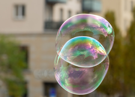 Soap bubbles in front of an old house and trees in Dresden Germany in autumn