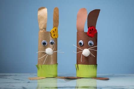Closeup of two Easter bunnies made of toilet paper rolls by a child Stock Photo - 93270304