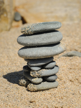 Closeup of a stack of grey pebbles on the beach