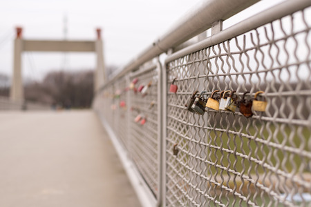 Various love padlocks locked to a bridge, Vienna Austria
