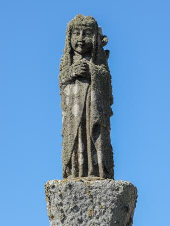 Stone figure in front of Chapelle Saint-They de la pointe du Van, Brittany France 写真素材
