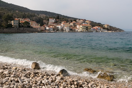 The beach of Valun (Island Cres, Croatia) on a cloudy day in spring