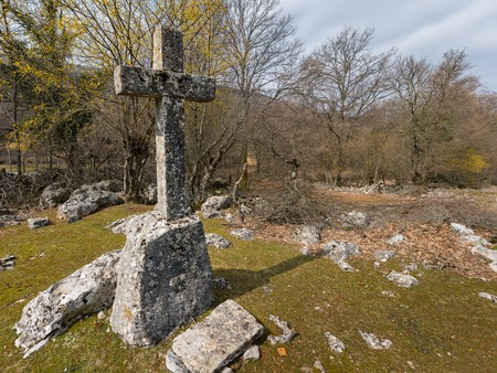 Stone cross near Beli (island Cres, Croatia) on a cloudy day in spring