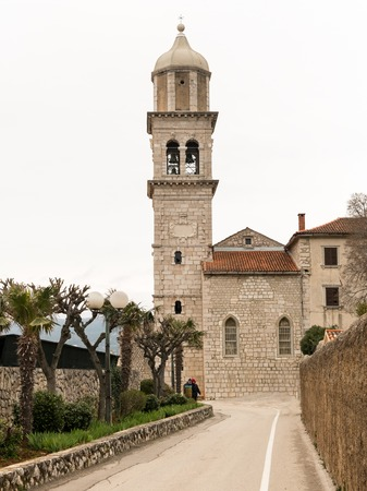 Church Sveti kriz in Cres (Croatia) on a cloudy day in spring 에디토리얼
