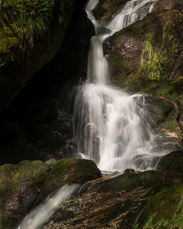 Waterfall, cascade between big rocks in ravine Ysperklamm (Waldviertel, Austria)