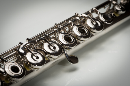Closeup of the keys of a platinum plated silver flute