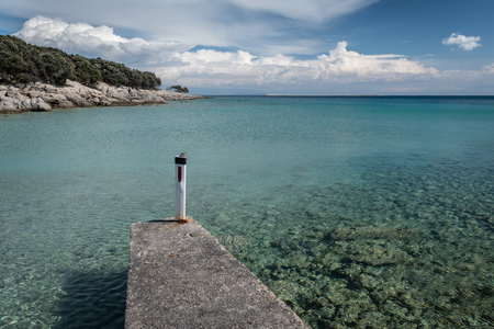 Jetty in the small port of Verin (Island Cres, Croatia) on a sunny day in spring