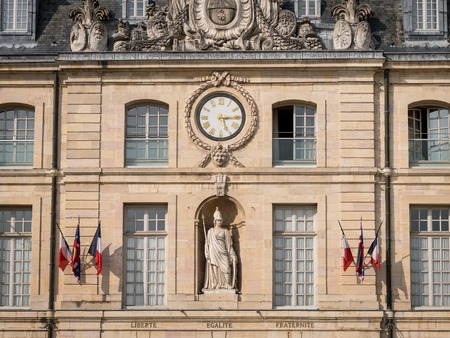 Facade of the town hall of Dijon (Burgundy, France) on a sunny day in summer. French inscription for liberty, equality, fraternity
