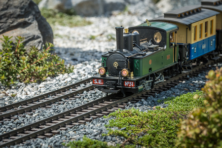 Railway modelling train outdoors on a sunny day, steam engine train Imagens