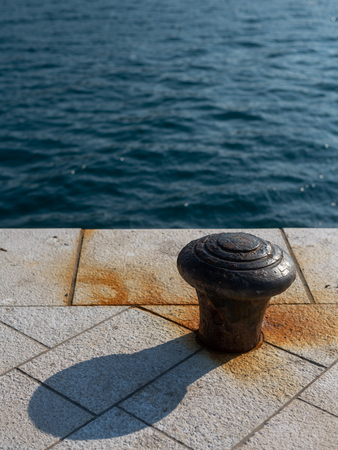 Rusty bollard in the harbour of Cres (Croatia)