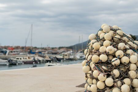 fishing nets lying at the beach in the port of Cres (Croatia)