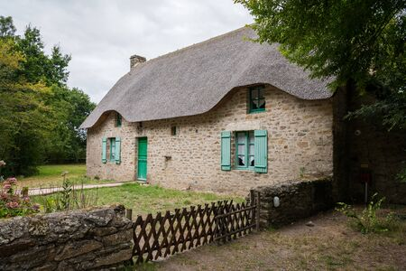old house in saint lyphard (France) with a thatched roof Reklamní fotografie - 128832680
