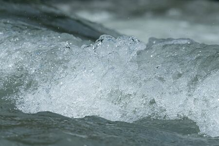 Closeup of the water in a small fast flowing river in the alps (South Tyrol) Banco de Imagens