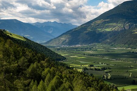 The Vnschgau valley near Laas (South Tyrol, Italy) on a partly cloudy day in summer