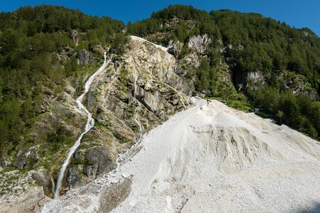 Marble quarry of Laas (South Tyrol, Italy) from below on a sunny day in summer Stock fotó