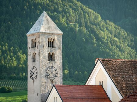 Church tower of St. Johannes in Laas (South Tyrol, Italy) on a sunny evening in summer Stockfoto - 130136128