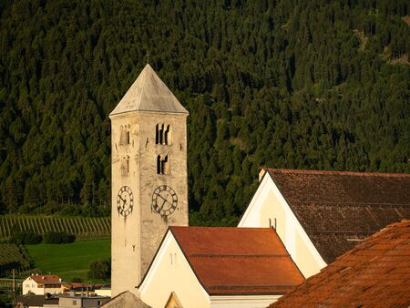 Church tower of St. Johannes in Laas (South Tyrol, Italy) on a sunny morning in summer Stockfoto - 130136152