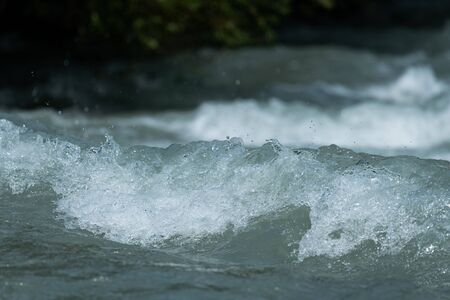 Closeup of the water in a small fast flowing river in the alps (South Tyrol) Stock Photo