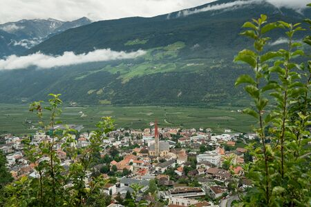 The city of Schlanders (South Tyrol, Italy) from above on a cloudy day in summer