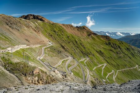 Some of the hairpin turns near the top of the eastern ramp of the Stelvio Pass (Southy Tyrol, Italy) on a sunny day in summer