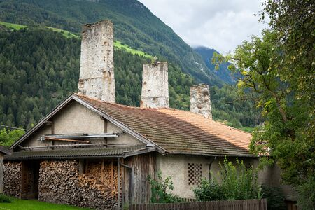 Remains of the old aqueduct in Laas (South Tyrol, Italy) on a cloudy day in summer
