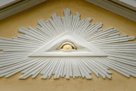 Closeup of the Eye of Providence over the entrance of church St. Johannes in Laas (South Tyrol, Italy) 写真素材