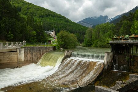 Weir on the river Schwarza in Hirschwang (Austria) on a cloudy day in summer
