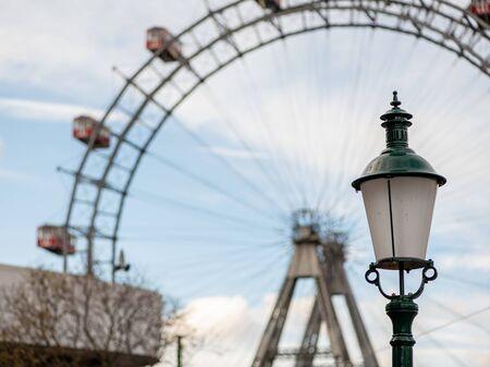 Lamp in front of Wiener Riesenrad (Vienna Giant Wheel) on a cloudy day in winter (Vienna, Austria)