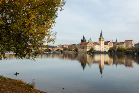 River Vltava and old buildings of Prague (Czech Republic) on a sunny day in autumn Stock fotó
