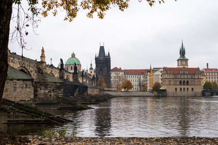 Charles bridge and tower in Prague (Czech Republic) on a cloudy day in autumn Reklamní fotografie