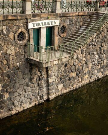 Public toilet near National Theatre at river Vltava in Prague (Czech Republic)