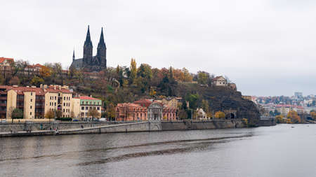 Fort Vysehrad with cathedral of Saint Peter and Saint Paul in Prague (Czech Republic) near river Vltava on a cloudy day in autumn
