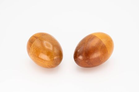 Closeup of two wooden egg shaker in front of a white background Stok Fotoğraf