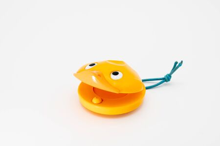 Closeup of castanets for children in shape of a yellow duck Stok Fotoğraf